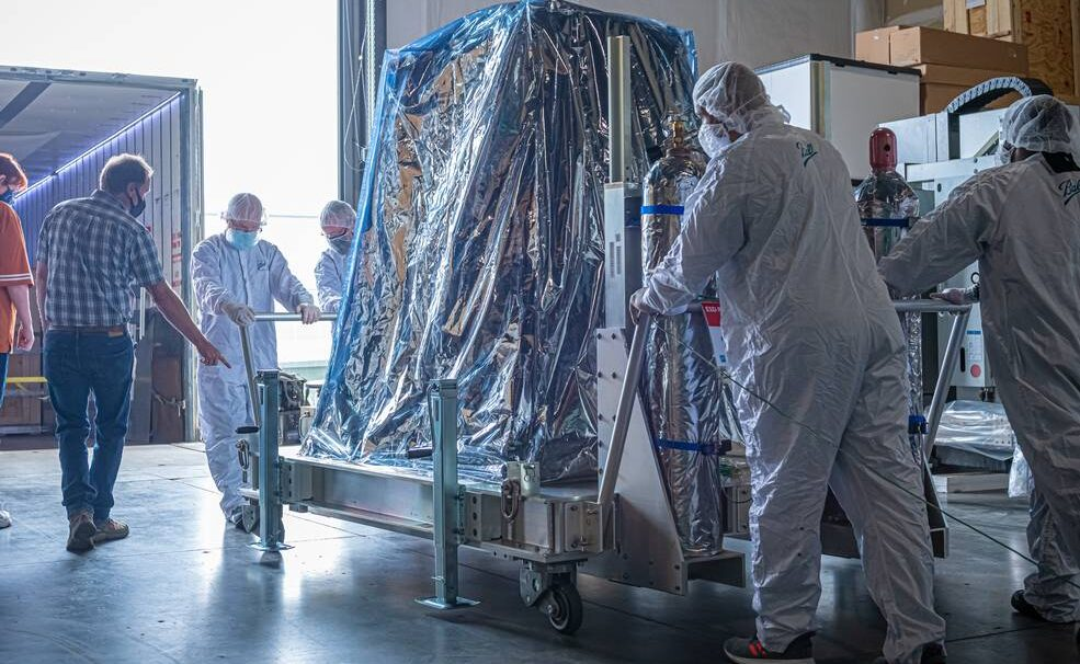 A crew at Ball Aerospace in Broomfield, Colorado, rolls the TEMPO satellite instrument onto a truck for shipment to Maxar Technologies' satellite manufacturing facility in Palo Alto, California. Credits: Ball Aerospace