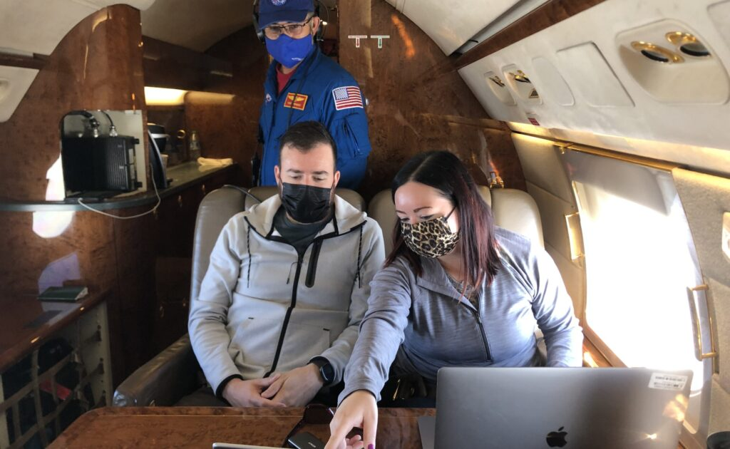 Flight safety officer Tony Henriquez, in blue, in the Gulfstream V's cabin with Langley's Taylor Shingler and TRACER-AQ Co-PI Laura Judd. Credits: NASA/Jayne Boehmler